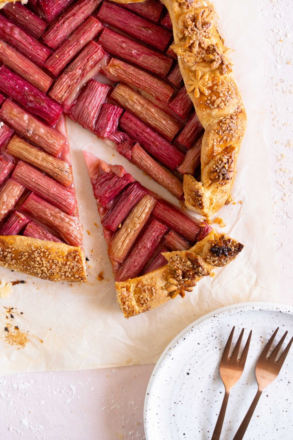 Rhubarb galette with a cornmeal crust. This easy rhubarb galette has a toasty cornmeal crust and a beautiful herringbone pattern. This galette is an easy spring dessert and is the perfect way to bake with rhubarb.