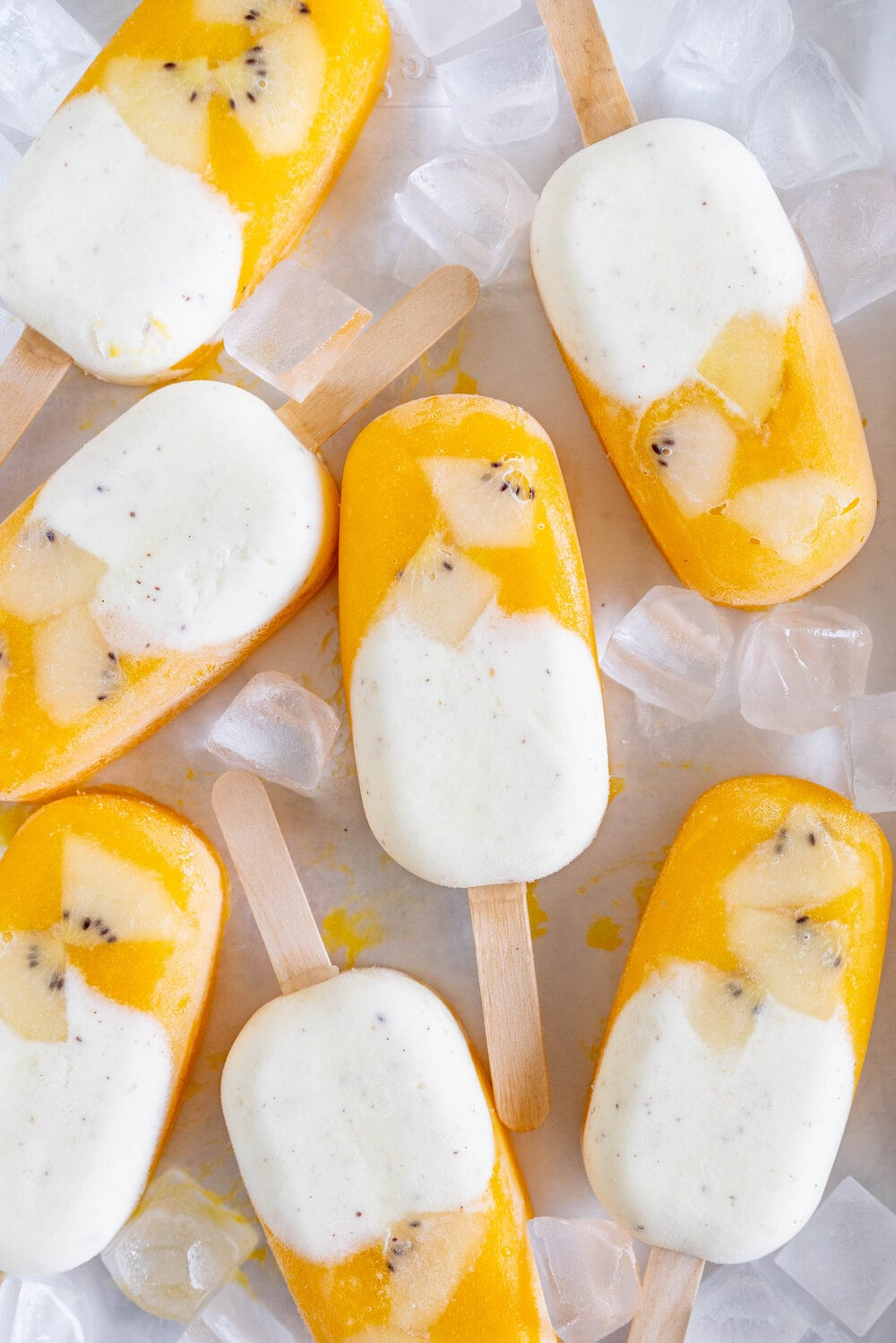 Kiwifruit and Mango Popsicles. Creamy Kiwifruit whipped cream and smooth mango puree are combined into this perfect popsicle. These pops are gluten free and super refreshing, and are great for using up summer fruit. There is no cooking required - simply blend up your fruit and you are ready to go!