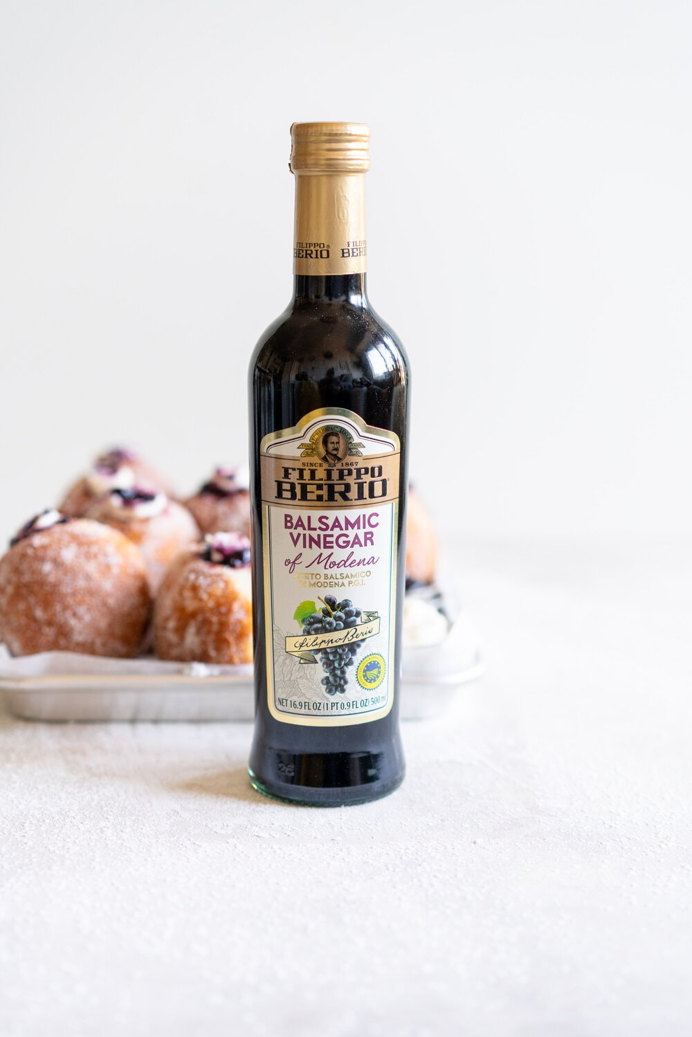 Fluffy doughnuts are fried until perfectly golden brown, then coated in sugar and filled with a whipped vanilla bean cheesecake filling and a balsamic blueberry compote. These are the most perfect treat!