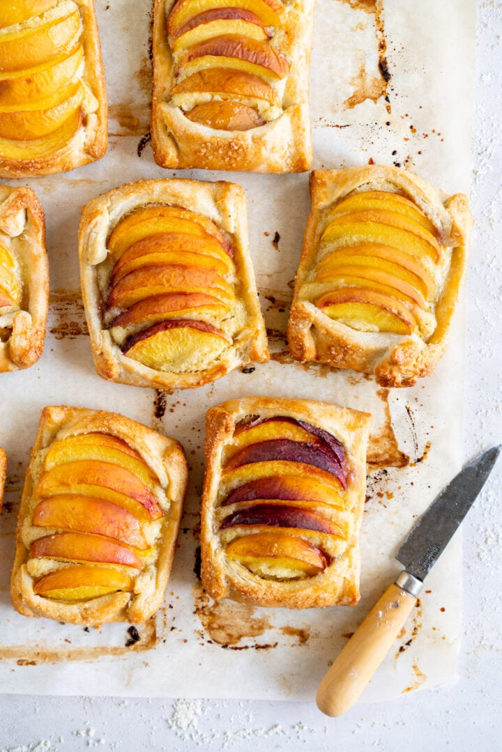 Baked peach galettes with knife