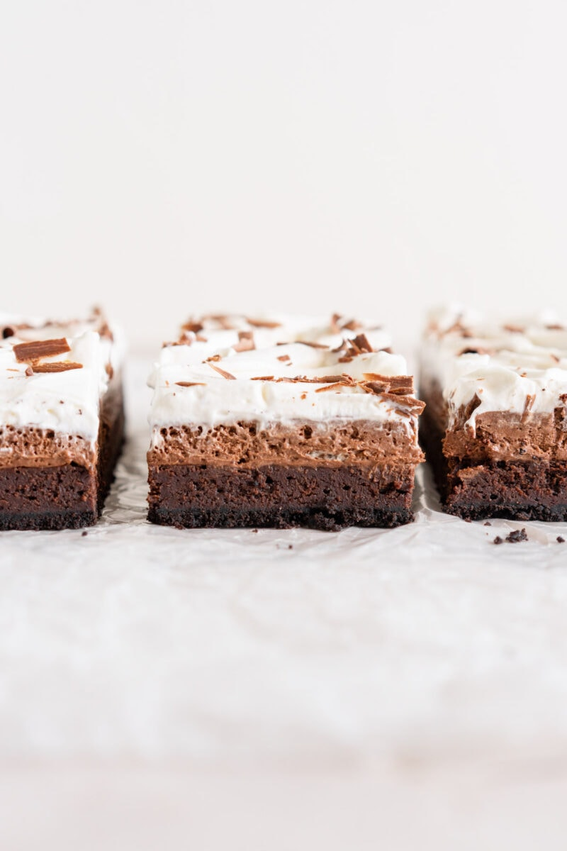 Lines of chocolate mud pie bars showing chocolate layers