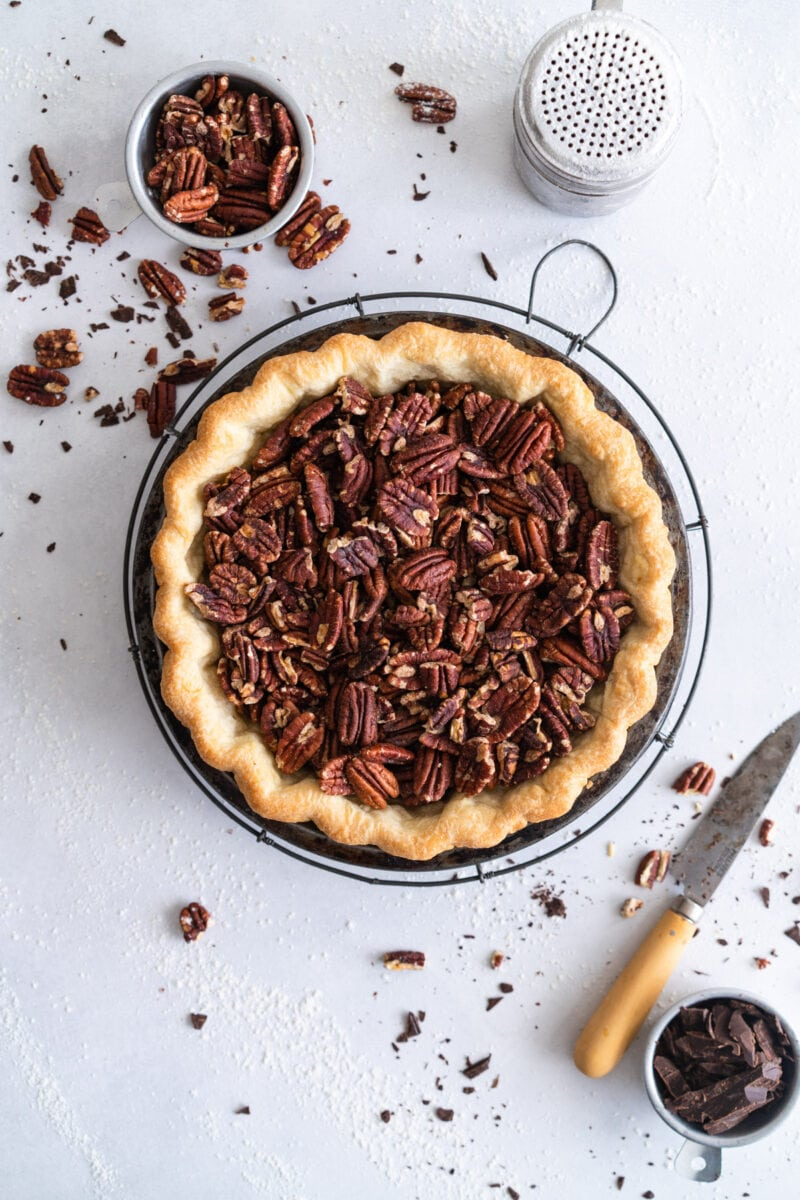 pecans in parbaked pie crust ready for oven