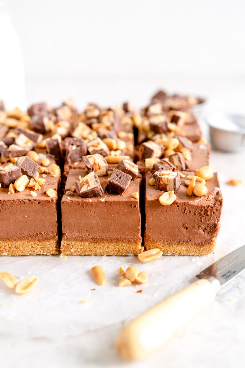 Cut up snickers cheesecake