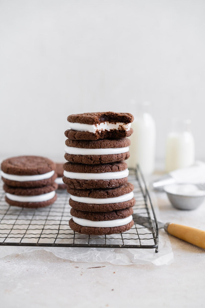 Stack of hot chocolate sugar cookies, with bite taken out of the top one.