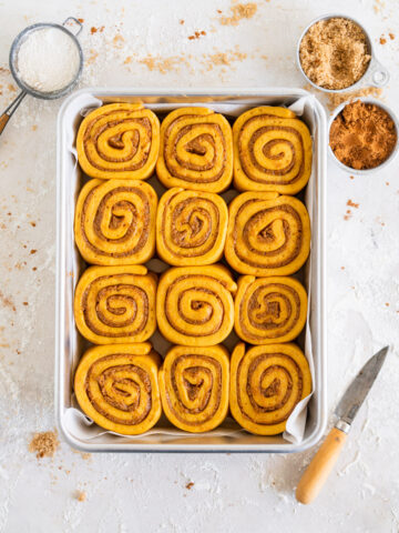 Pumpkin Cinnamon Rolls in a pan, ready to be baked