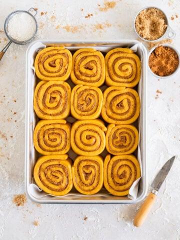 Pumpkin Cinnamon Rolls in a pan, ready to be baked