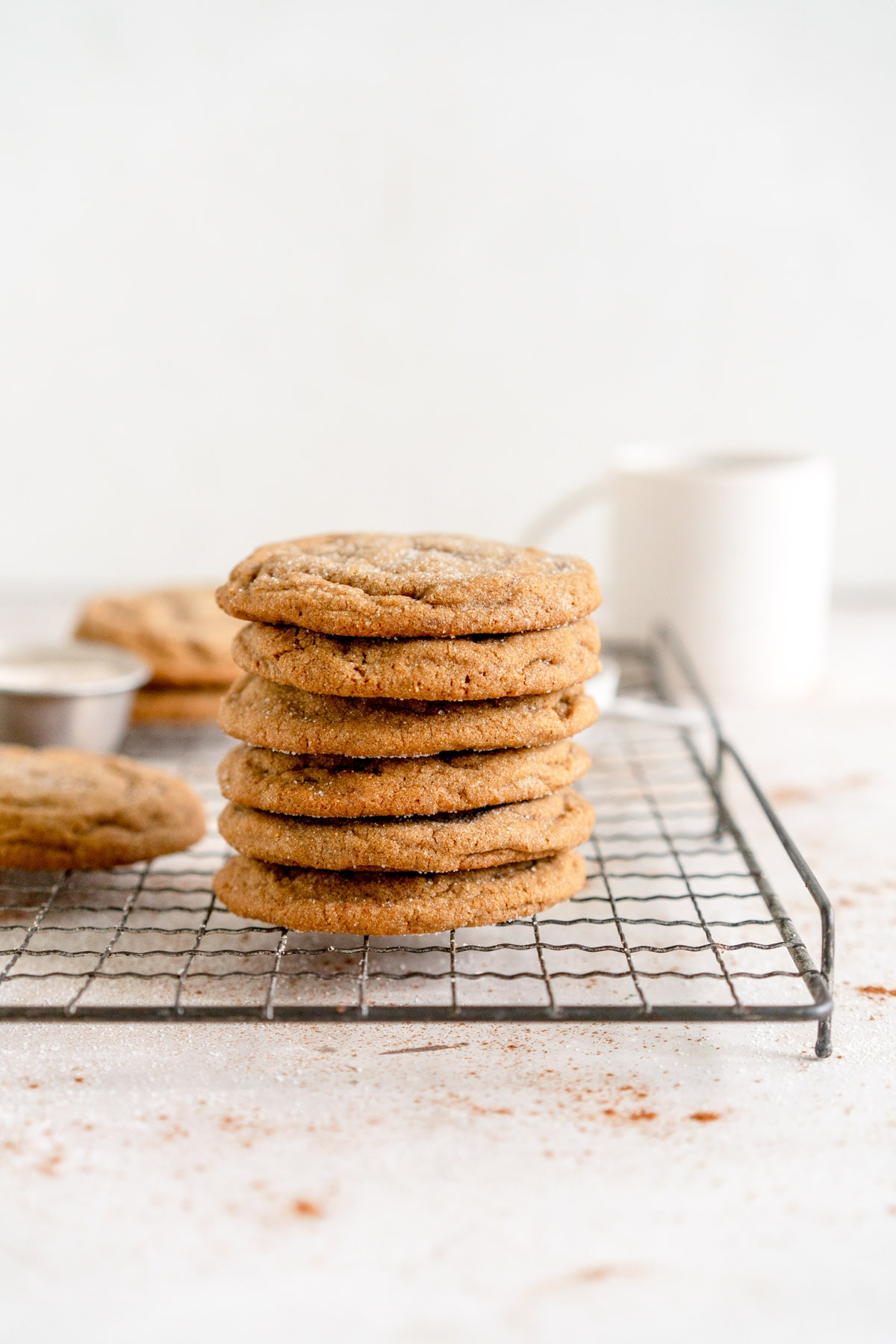 ginger molasses cookies stacked on rack
