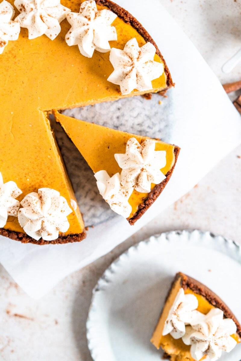 Top down shot of slice of pumpkin cheesecake