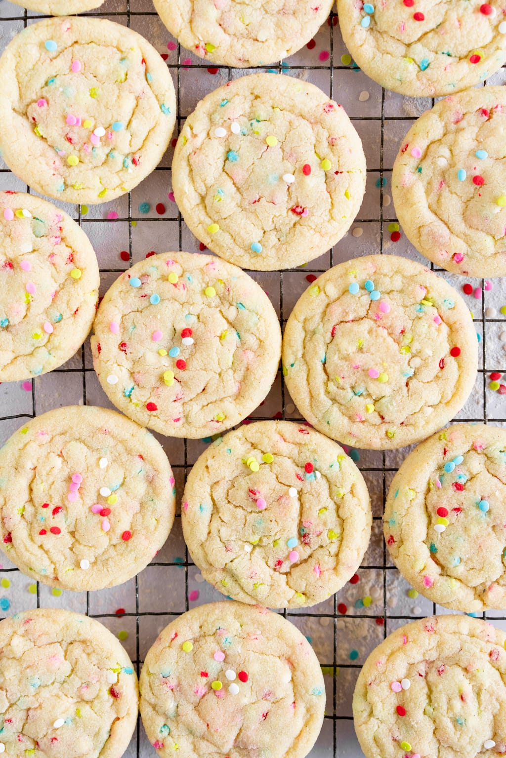close up shot of funfetti sugar cookies on wire rack