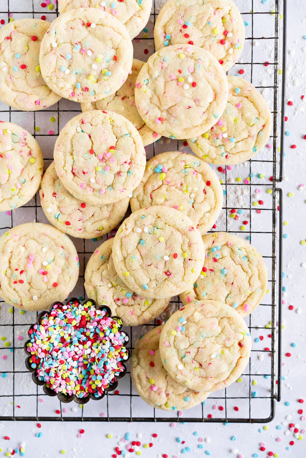 stacked up funfetti sugar cookies on wire rack