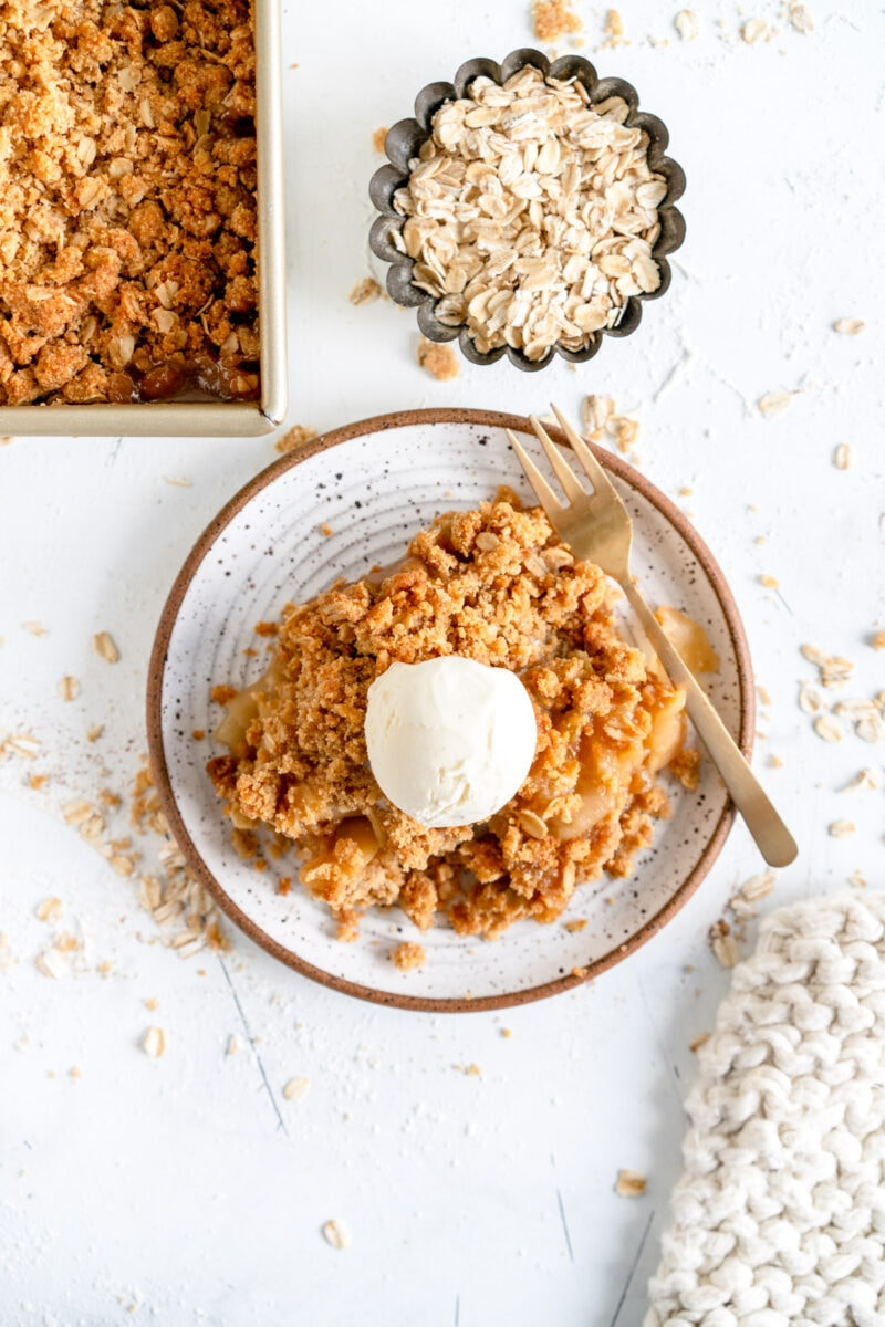 apple crumble on plate with ice cream