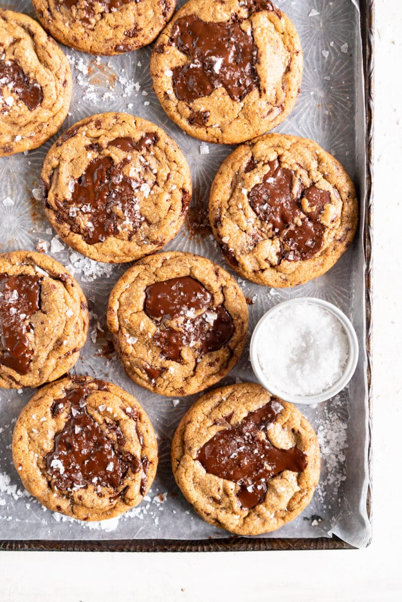 cookies with chocolate puddles on sheet pan