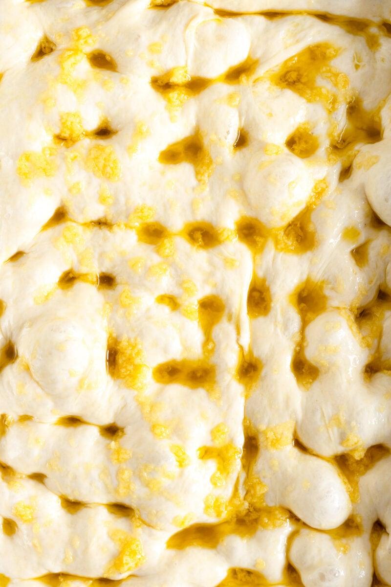 close up image of dimpled focaccia dough