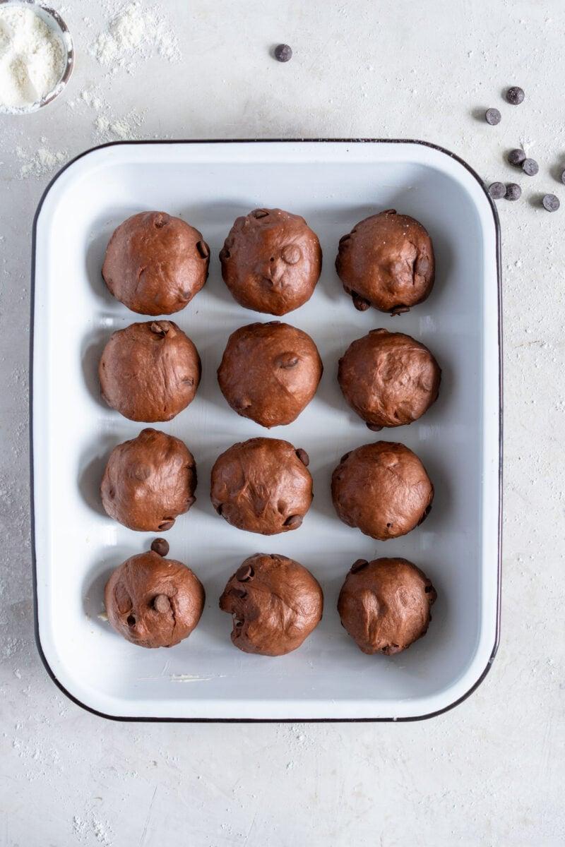 chocolate cardamom hot cross buns ready to rise