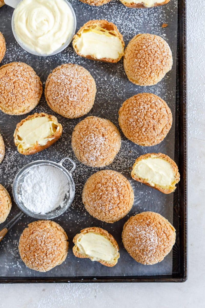 filled cream puffs on sheet pan