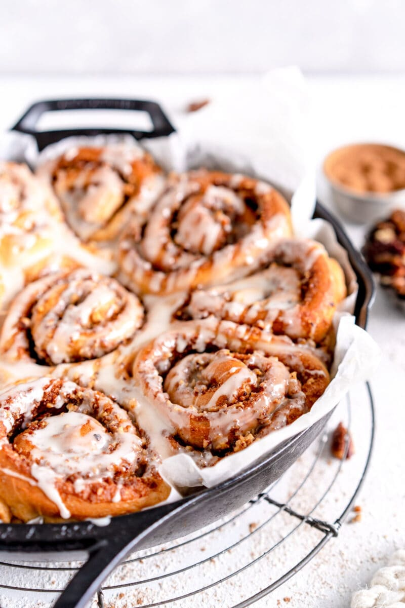 close up vegan cinnamon rolls with frosting