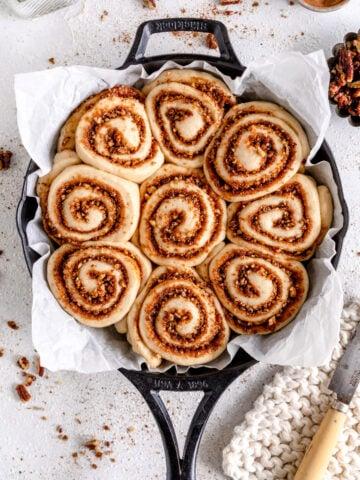 vegan cinnamon rolls in skillet