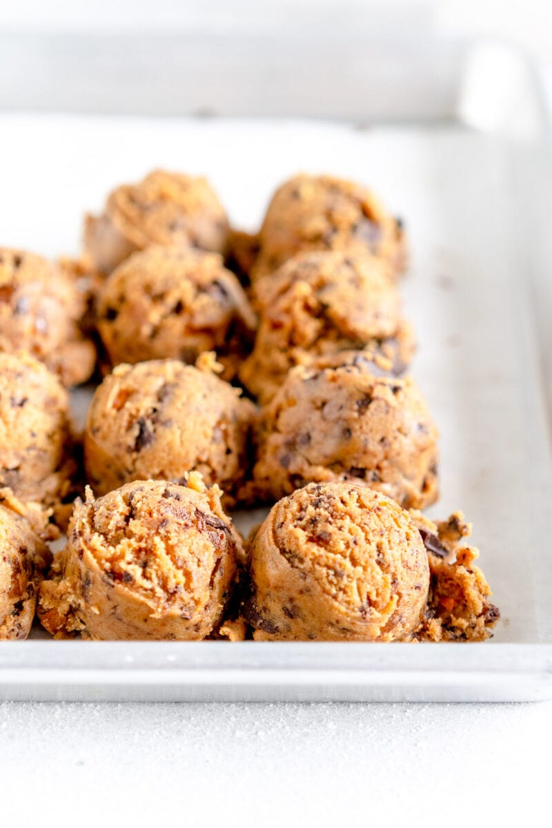 side on shot of cookie dough balls