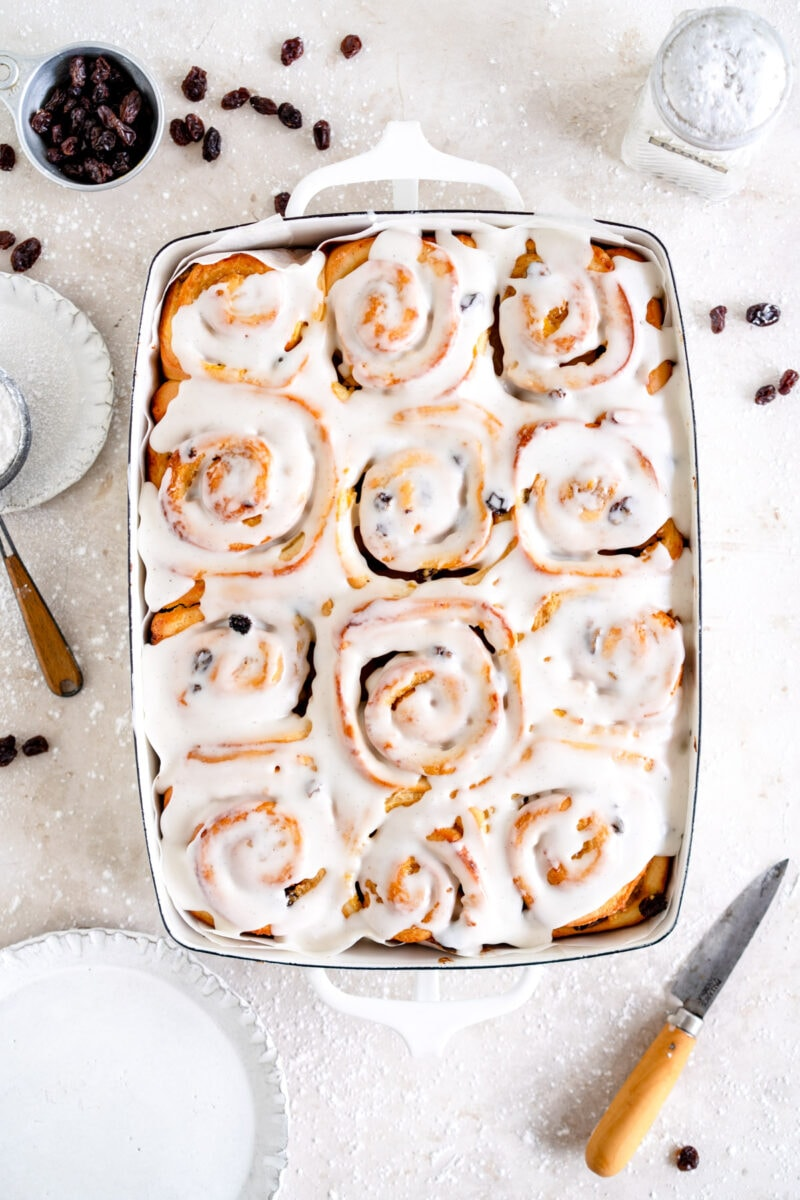 pan of iced chelsea buns