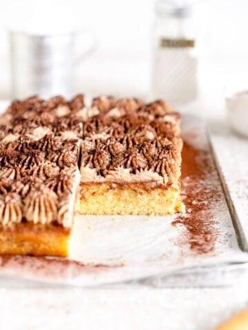 side cut shot of tiramisu sheet cake